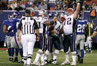 EAST RUTHERFORD, NJ - AUGUST 31:  Matt Light #72 and Dan Koppen #67 of the New England Patriots celebrates a touchdown by teammate Heath Evans #44 against the New York Giants during their preseason game against at Giants Stadium on August 31, 2006 in East