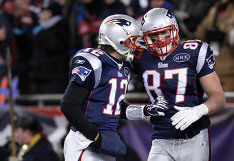 FOXBORO, MA - JANUARY 14:  (L-R) Tom Brady #12 and Rob Gronkowski #87 of the New England Patriots celebrate after Gronkowski caught a 10-yard touchdown reception from Brady in the first quarter against the Denver Broncos during their AFC Divisional Playof