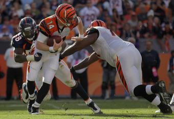 DENVER, CO - SEPTEMBER 18:  Line backer Von Miller #58 of the Denver Broncos sacks quarterback Andy Dalton #14 of the Cincinnati Bengals at Invesco Field at Mile High on September 18, 2011 in Denver, Colorado. The Broncos defeated the Bengals 24-22.  (Pho