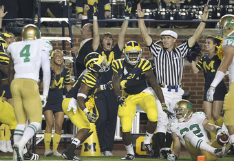 ANN ARBOR, MI - SEPTEMBER 10: Junior Hemingway #21 of the Univerity of Michigan scores on a 43 yard touchdown pass from Denard Robinson #16 in the second quarter during the game against the Notre Dame Fighting Irish at Michigan Stadium on September 10, 20
