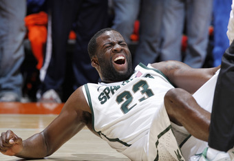CHAMPAIGN, IL - JANUARY 31: Draymond Green #23 of the Michigan State Spartans grimaces in pain after suffering an injury against the Illinois Fighting Illini at Assembly Hall on January 31, 2012 in Champaign, Illinois. Illinois defeated Michigan State 42-