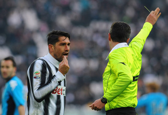 TURIN, ITALY - FEBRUARY 05:  Marco Borriello of Juventus FC receives a yellow card from referee Sebastiano Peruzzo during the Serie A match between Juventus FC and AC Siena at Juventus Arena on February 5, 2012 in Turin, Italy.  (Photo by Valerio Pennicin