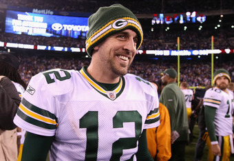 EAST RUTHERFORD, NJ - DECEMBER 04:  Aaron Rodgers #12 of the Green Bay Packers celebrates after the Packers won 38-35 against the New York Giants at MetLife Stadium on December 4, 2011 in East Rutherford, New Jersey.  (Photo by Al Bello/Getty Images)