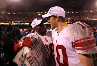 SAN FRANCISCO, CA - JANUARY 22:  (L-R) Hakeem Nicks #88 and Eli Manning #10 of the New York Giants celebrate on the field after they won 20-17 in overtime against the San Francisco 49ers during the NFC Championship Game at Candlestick Park on January 22,