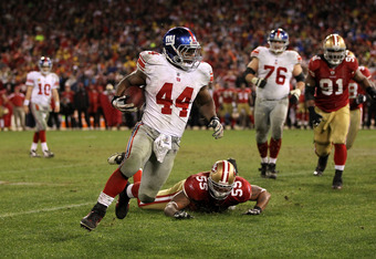 SAN FRANCISCO, CA - JANUARY 22:  Ahmad Bradshaw #44 of the New York Giants runs the bal lagainst Ahmad Brooks #55 of the San Francisco 49ers during the NFC Championship Game at Candlestick Park on January 22, 2012 in San Francisco, California.  (Photo by