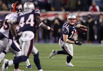 FOXBORO, MA - JANUARY 14:  Julian Edelman #11 of the New England Patriots runs with the ball against the Denver Broncos during their AFC Divisional Playoff Game at Gillette Stadium on January 14, 2012 in Foxboro, Massachusetts.  (Photo by Jim Rogash/Getty