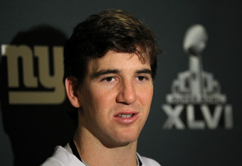 INDIANAPOLIS, IN - FEBRUARY 01:  Eli Manning #10 of the New York Giants answers questions from the press during a media availability session for Super Bowl XLVI at the Indianapolis Downtown Marriott on February 1, 2012 in Indianapolis, Indiana.  (Photo by