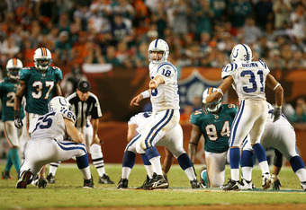 MIAMI - SEPTEMBER 21:  Quarterback Peyton Manning #18 of the Indianapolis Colts points out where he wants his running backs while taking on the Miami Dolphins at Land Shark Stadium on September 21, 2009 in Miami, Florida. The Colts defeated the Dolphins 2