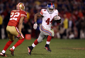 SAN FRANCISCO, CA - JANUARY 22:  Ahmad Bradshaw #44 of the New York Giants runs the ball against Carlos Rogers #22 of the San Francisco 49ers during the NFC Championship Game at Candlestick Park on January 22, 2012 in San Francisco, California.  (Photo by
