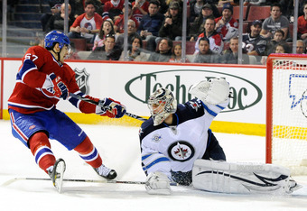 MONTREAL, CANADA - FEBRUARY 5:  Ondrej Pavelec #31 of the Winnipeg Jets stops the puck on an attempt by Max Pacioretty #67 of the Montreal Canadiens during the NHL game at the Bell Centre on February 5, 2012 in Montreal, Quebec, Canada.  (Photo by Richard