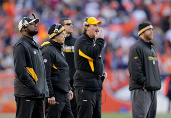 DENVER, CO - JANUARY 08:  Head coach Mike Tomlin (L) of the Pittsburgh Steelers looks on during the AFC Wild Card Playoff game against the Denver Broncos at Sports Authority Field at Mile High on January 8, 2012 in Denver, Colorado.  (Photo by Doug Pensin