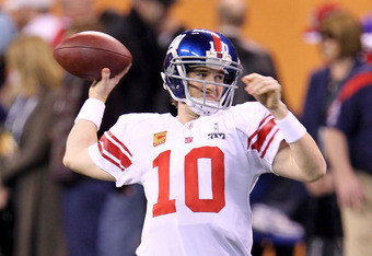 INDIANAPOLIS, IN - FEBRUARY 05:  Quarterback Eli Manning #10 of the New York Giants warms up prior to playing the New England Patriots during Super Bowl XLVI at Lucas Oil Stadium on February 5, 2012 in Indianapolis, Indiana.  (Photo by Andy Lyons/Getty Im