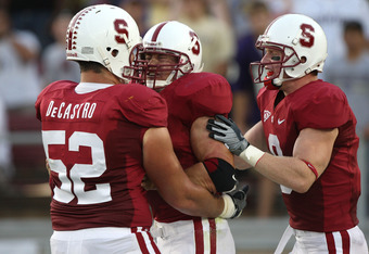 PALO ALTO, CA - SEPTEMBER 26:  Toby Gerhart #7 of the Stanford Cardinal celebrates with David DeCastro #52 and Ryan Whalen #8 after scoring a touchdown against the Washington Huskies at Stanford Stadium on September 26, 2009 in Palo Alto, California.  (Ph