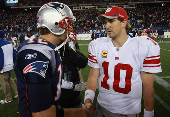 FOXBORO, MA - NOVEMBER 6:    Tom Brady #12 of the New England Patriots congratulates  Eli Manning #10 of the New York Giants after the New York Giants 24-20 win on November 6, 2011 in Foxboro, Massachusetts. (Photo by Jim Rogash/Getty Images)