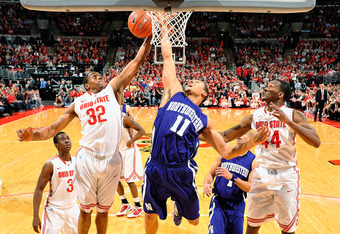 COLUMBUS, OH - DECEMBER 28:  Lenzelle Smith, Jr. #32 of the Ohio State Buckeyes grabs a round ahead of Reggie Hearn #11 of the Northwestern Wildcats on December 28, 2011 at Value City Arena in Columbus, Ohio. Ohio State defeated Northwestern 87-54.   (Pho