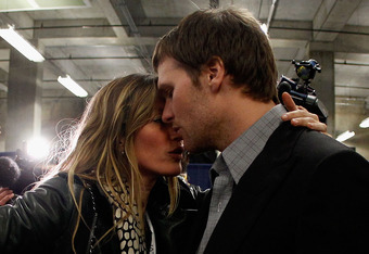 INDIANAPOLIS, IN - FEBRUARY 05:  Tom Brady #12 of the New England Patriots is comforted by his wife Gisele Bundchen after losing to the New York Giants by a score of 21-17 in Super Bowl XLVI at Lucas Oil Stadium on February 5, 2012 in Indianapolis, Indian