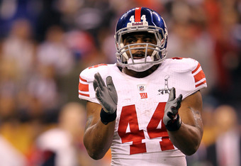 INDIANAPOLIS, IN - FEBRUARY 05:  Ahmad Bradshaw #44 of the New York Giants reacts against the New England Patriots during Super Bowl XLVI at Lucas Oil Stadium on February 5, 2012 in Indianapolis, Indiana.  (Photo by Jamie Squire/Getty Images)