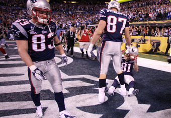 INDIANAPOLIS, IN - FEBRUARY 05:  Wes Welker #83, Rob Gronkowski #87 and Aaron Hernandez #81 of the New England Patriots wait in the end zone after losing to the New York Giants 21-17 during Super Bowl XLVI at Lucas Oil Stadium on February 5, 2012 in India