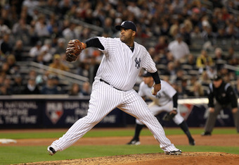 NEW YORK, NY - OCTOBER 06:  CC Sabathia #52 of the New York Yankees throws a pitch against the Detroit Tigers during Game Five of the American League Championship Series at Yankee Stadium on October 6, 2011 in the Bronx borough of New York City. The Tiger