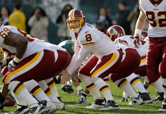 PHILADELPHIA, PA - JANUARY 01: Quarterback Rex Grossman #8 of the Washington Redskins calls a signal under center against the Philadelphia Eagles  at Lincoln Financial Field on January 1, 2012 in Philadelphia, Pennsylvania.  (Photo by Rob Carr/Getty Image