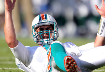 MIAMI GARDENS, FL - JANUARY 01: Quarterback Matt Moore #8 of the Miami Dolphins celebrates a touchdown reception against the New York Jets at Sun Life Stadium on January 1, 2012 in Miami Gardens, Florida.  (Photo by Marc Serota/Getty Images)