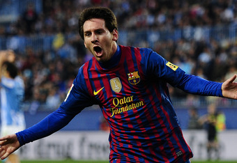 MALAGA, SPAIN - JANUARY 22:  Lionel Messi of FC Barcelona celebrates after scoring the opening goal during the La Liga match between Malaga CF and FC Barcelona at Rosaleda Stadium on January 22, 2012 in Malaga, Spain. FC Barcelona won 4-1. (Photo by David