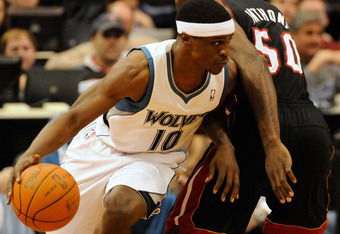 MINNEAPOLIS, MN - APRIL 1: Jonny Flynn #10 of the Minnesota Timberwolves dribbles around Joel Anthony #50 of the Miami Heat during a basketball game at Target Center on April 1, 2011 in Minneapolis, Minnesota. NOTE TO USER: User expressly acknowledges and
