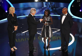 LONDON, ENGLAND - FEBRUARY 06:  TV Presenter Steve Rider speaks with Academy member Kip Keino and Laureus World Sportswoman of the Year winner Vivian Cheruiyot with Academy member Martina Navratilova on stage at the 2012 Laureus World Sports Awards at Cen