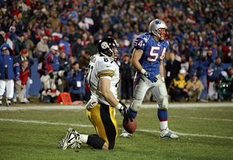 13 Dec 1997:  Mark Bruener #87 of the Pittsburgh Steelers and Tedy Bruschi #54 of the New England Patriots look on during a game at Foxboro Stadium in Foxboro, Massachusetts. The Steelers defeated the Patriots 24-21. Mandatory Credit: Brian Bahr  /Allspor