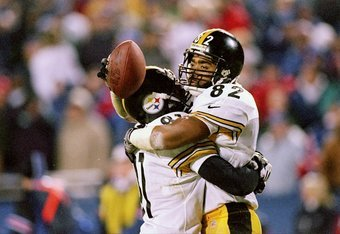 13 Dec 1997:  Wide receiver Yancey Thigpen #82 of the Pittsburgh Steelers celebrates with teammate Charles Johnson #81 after catching the game tying 2-point conversion during the Steelers 24-21 win over the New England Patriots at Foxboro Stadium in Foxbo