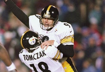 13 Dec 1997:  Kicker Norm Johnson #9 of the Pittsburgh Steelers celebrates with holder Mike Tomczak #18 during the Steelers 24-21 win over the New England Patriots at Foxboro Stadium in Foxboro, Massachusetts. Mandatory Credit: Brian Bahr  /Allsport