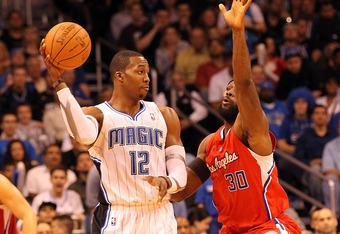 ORLANDO, FL - FEBRUARY 06:  Dwight Howard #12 of the Orlando Magic is guarded by Reggie Evans #30 of the Los Angeles Clippers during the game at Amway Center on February 6, 2012 in Orlando, Florida.   NOTE TO USER: User expressly acknowledges and agrees t