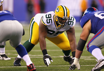EAST RUTHERFORD, NJ - DECEMBER 04:  Howard Green #95 of the Green Bay Packers lines up on defense against the New York Giants at MetLife Stadium on December 4, 2011 in East Rutherford, New Jersey. The Packers won 38-35.  (Photo by Al Bello/Getty Images)