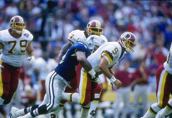 2 Oct 1994: Defensive lineman Charles Haley of the Dallas Cowboys tackles Washington Redskins quarterback Heath Shuler during a game at RFK Stadium in Washington, D. C. The Cowboys won the game, 34-7.