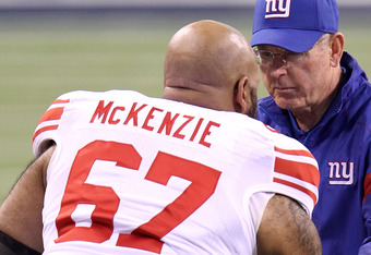 INDIANAPOLIS, IN - FEBRUARY 05:  Head coach Tom Coughlin of the New York Giants talks with Kareem McKenzie #67 on the sideline prior to Super Bowl XLVI against the New England Patriots at Lucas Oil Stadium on February 5, 2012 in Indianapolis, Indiana.  (P