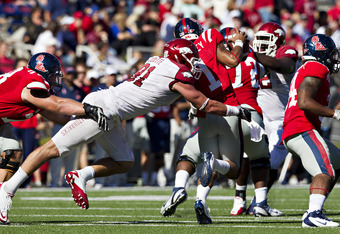 OXFORD,  MS - OCTOBER 22:  Jake Bequette #91 of the Arkansas Razorbacks hits quarterback Randall Mackey #1 of the Ole Miss Rebels at Vaught-Hemingway Stadium on October 22, 2011 in Oxford, Mississippi.  The Razorbacks defeated the Rebels 29 to 24.  (Photo