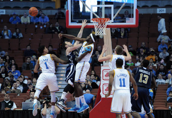 ANAHEIM, CA - DECEMBER 17:  Anthony Stover #0 of the UCLA Bruins blocks the shot of Eddie Miller #21 of the UC Davis Aggies during the first half at Honda Center on December 17, 2011 in Anaheim, California.  (Photo by Harry How/Getty Images)