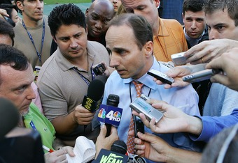 NEW YORK - OCTOBER 07:  General manager Brian Cashman of the New York Yankees speaks to the media before Game Three of the American League Division Series against the Cleveland Indians at Yankee Stadium on October 7, 2007 in the Bronx borough of New York