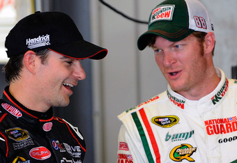 SPARTA, KY - JULY 07: Jeff Gordon (L), driver of the #24 DuPont Chevrolet, talks with Dale Earnhardt Jr. (R), driver of the #88 Diet Mountain Dew/National Guard Chevrolet, in the garage during testing for the NASCAR Sprint Cup Series at Kentucky Speedway