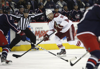 COLUMBUS, OH - JANUARY 13:  Shane Doan #19 of the Phoenix Coyotes moves the puck up ice during the game against the Columbus Blue Jackets at Nationwide Arena on January 13, 2012 in Columbus, Ohio.  (Photo by John Grieshop/Getty Images)