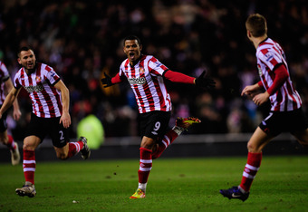 SUNDERLAND, ENGLAND - FEBRUARY 01:  Sunderland striker Frazier Campbell celebrates after scoring the first Sunderland goal during the Barclays Premier League game between Sunderland and Norwich City at Stadium of Light on February 1, 2012 in Sunderland, E