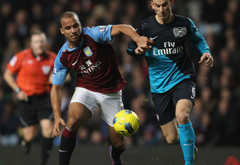 BIRMINGHAM, ENGLAND - DECEMBER 21:  Laurent Koscielny of Arsenal is tackled by Gabby Agbonlahor of Aston Villa during the Barclays Premier League match between Aston Villa and Arsenal at Villa Park on December 21, 2011 in Birmingham, England.  (Photo by C