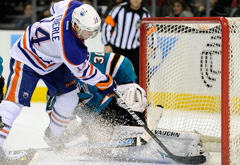 SAN JOSE, CA - DECEMBER 17: Jordan Eberle #14 of the Edmonton Oilers scores a goal on goaltender Antti Niemi #31 of the San Jose Sharks at HP Pavilion at San Jose on December 17, 2011 in San Jose, California.  (Photo by Thearon W. Henderson/Getty Images)