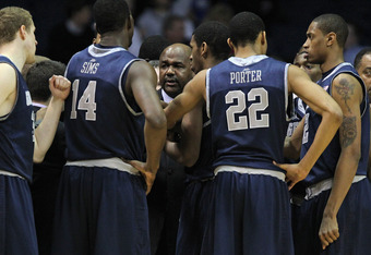 ROSEMONT, IL - JANUARY 17: Head coach John Thompson III of the Georgetown Hoyas gives instructions to players including Henry Sims #14 and Otto Porter #22 during a game against the DePaul Blue Demons at Allstate Arena on January 17, 2012 in Rosemont, Illi
