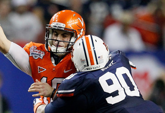 ATLANTA, GA - DECEMBER 31:  Gabe Wright #90 of the Auburn Tigers pressures Michael Rocco #16 of the Virginia Cavaliers during the 2011 Chick Fil-A Bowl at Georgia Dome on December 31, 2011 in Atlanta, Georgia.  (Photo by Kevin C. Cox/Getty Images)