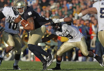 SOUTH BEND, IN - OCTOBER 29: Michael Floyd #3 of the Notre Dame Fighting Irish breaks away from Tra'ves Bush #9 of the Navy Midshipmen at Notre Dame Stadium on October 29, 2011 in South Bend, Indiana. Notre Dame defeated Navy 56-14. (Photo by Jonathan Dan
