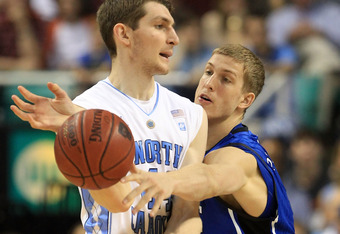 GREENSBORO, NC - MARCH 13:  Mason Plumlee #5 of the Duke Blue Devils tries to steal the ball from Tyler Zeller #44 of the North Carolina Tar Heels during the first half in the championship game of the 2011 ACC men's basketball tournament at the Greensboro