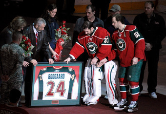 ST PAUL, MN - NOVEMBER 27: The family of the late Derek Boogaard  shake hands receive a game worn jersey from Josh Harding #37 and Nick Schultz #55 of the Minnesota Wild during an on ice presentation prior to the game on November 27, 2011 at Xcel Energy C