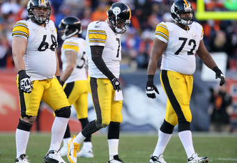 DENVER, CO - JANUARY 08:  Chris Kemoeatu #68, Ben Roethlisberger #7 and Jonathan Scott #72 of the Pittsburgh Steelers walk off the field after a play against the Denver Broncos during the AFC Wild Card Playoff game at Sports Authority Field at Mile High o