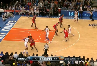 Both defenders who were on Jared Jeffries (No. 8) move to Lin, who sets up for a bounce pass.